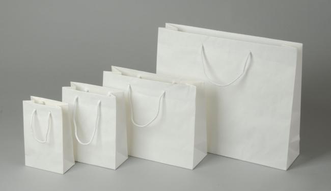 Papírová taška o rozměru 160 x 80 x 250  mm,bílý sulfátový papír, bavlněné držadlo