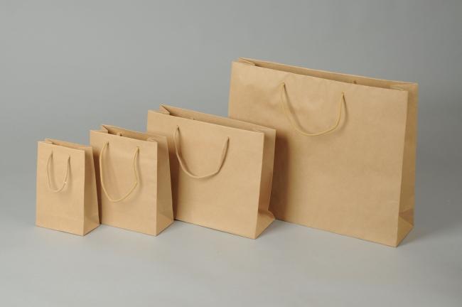Papírová taška o rozměru 540 x 140 x 445 mm,hnědý sulfátový papír, bavlněné držadlo